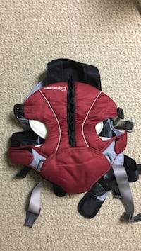 Baby's red and gray carrier