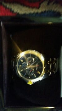 round gold chronograph watch with black leather strap 3749 km