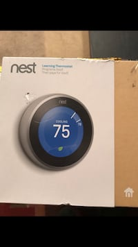 Black and gray nest learning thermostat box works with Alexa  48 mi