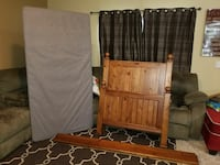 brown wooden bed headboard and footboard Port St. Lucie, 34983