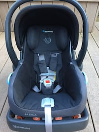baby's black UppaBaby carrier car seat