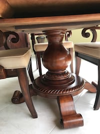 Round four footed pedestal table