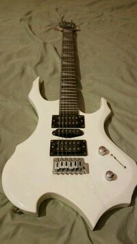 white and black electric guitar Hyattsville, 20785