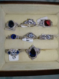 eight silver-colored ring with gemstones