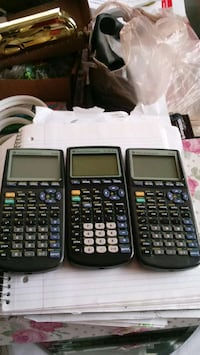 four black and gray Texas Instruments graphing calculators Fairfax, 22032
