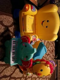 three Fisher-Price learning chair and walkers
