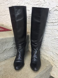pair of black leather knee-high boots 2473 km