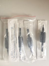 Tattoo needles with case.