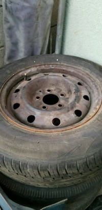 """2 tires and rims, used gd condition 15"""" 5 on 4 1/2"""