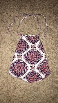 Colorful patterned halter neck top with a pointed bottom bought from Charlotte Russe size M