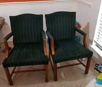 two blue padded brown wooden armchairs Houston, 77093