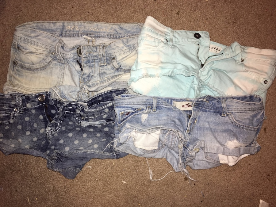Four blue and white denim shorts