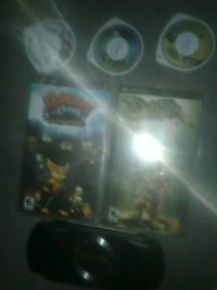 Psp with 5 games and charger sorry about the photos my camera is crap  Toronto, M6G 3W1