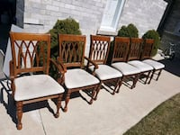 four brown wooden framed white padded chairs Mississauga, L5N
