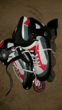 pair of white-red-gray-and-lack in-line skates Ajax, L1T
