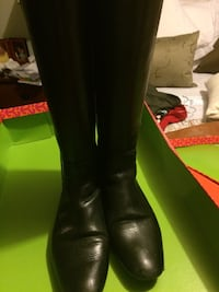 pair of black leather knee-high boots Brampton, L6Z 1A2