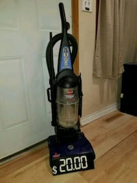 black and blue Bissell upright vacuum cleaner 612 mi