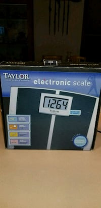NEW IN BOX TAYLOR SLIM PROFILE LITHIUM SCALE.  Middleborough, 02346