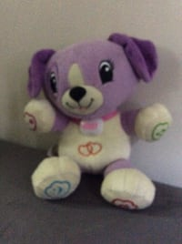 purple and white Fisher-Price Laugh & Learn puppy