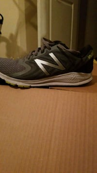 pair of gray-and-black Nike running shoes 2066 mi