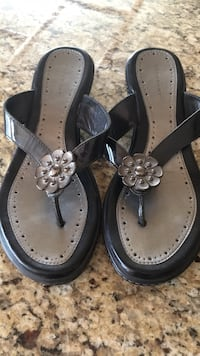 pair of black leather sandals Calgary, T3A 3R8