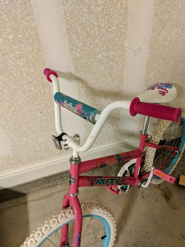 Girl's pink and white bicycle
