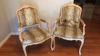 two brown wooden framed padded armchairs Tampa, 33625