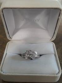 silver diamond ring in box FLINT