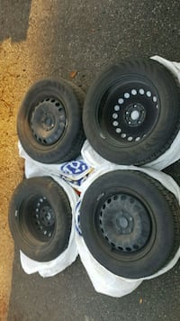 four black bullet hole vehicle wheels and tires Guelph, N1H 6J4