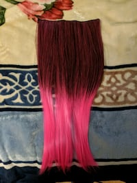 Black in neon pink clip on extensions.