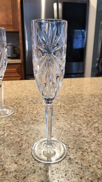 5 tall champagne glasses. Never used. Stanton, 90680