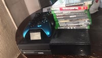 Black xbox one console with controller and game cases Los Angeles, 90015
