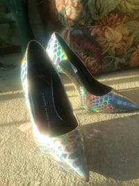 pair of silver-colored pointed-toe pumps Mississippi