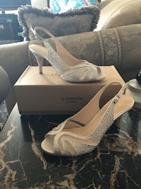 pair of silver Le Chateau peep-toe sling back heeled sandals with box
