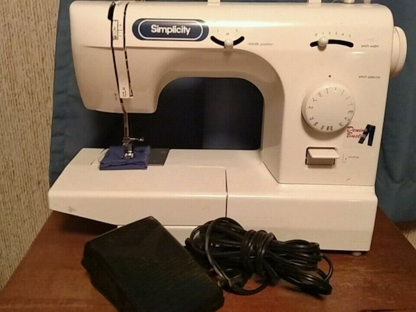 white and blue Simplicity brand sewing machine