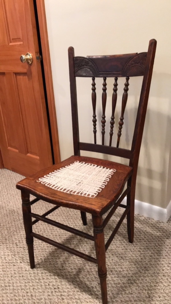 brown wooden framed white padded chair