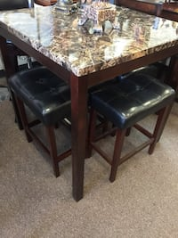 rectangular brown wooden table with four chairs dining set Houston, 77074