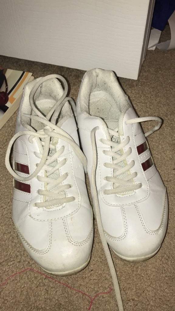 white Adidas low top lace up shoes