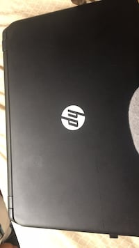 black HP laptop with AC adapter null