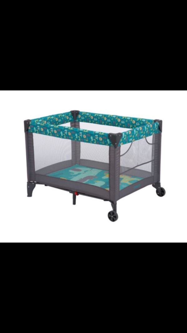 black and green Graco pack n play
