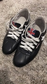 pair of black-and-white Adidas sneakers Milton, L9T 6W5