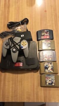 Black nes console; game controller; 5 video game cartridges Middle Smithfield, 18302