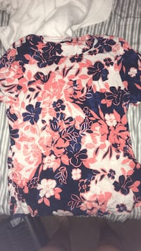 pink, white ,and blue floral t-shirt