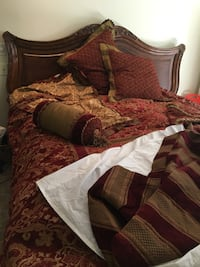 brown and red floral bed sheet 16 mi