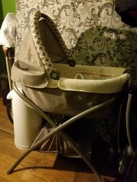 baby's white and gray bassinet Dolton