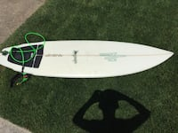 White surfboard with traction pad