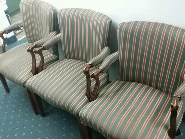 Three white-and-green stripe sofa chairs