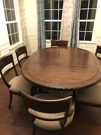 round brown wooden table with four chairs dining set Gainesville