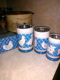 three blue-and-white duck-print canisters