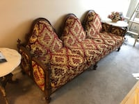 brown wooden frame with floral padded couch and  armchair Mississauga